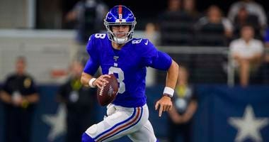 New York Giants quarterback Daniel Jones (8) rolls out against the Dallas Cowboys during the second half at AT&T Stadium