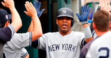 Sep 12, 2019; Detroit, MI, USA; New York Yankees designated hitter Edwin Encarnacion (30) receives congratulations from teammates after he hit a tworun home run in the third inning against the Detroit Tigers at Comerica Park.