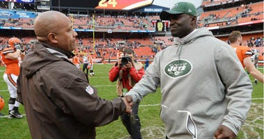 Hue Jackson shakes hands with Todd Bowles after the game at FirstEnergy Stadium in Cleveland.