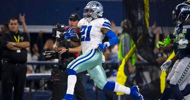 Cowboys running back Ezekiel Elliott runs for a first down against the Seattle Seahawks on Jan. 5, 2019, in an NFC wild-card game at AT&T Stadium in Arlington, Texas.