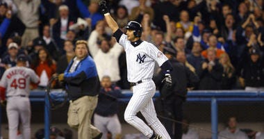 The Yankees' Aaron Boone celebrates after hitting the game-winning home run in the bottom of the 11th inning against the Boston Red Sox during Game 7 of the American League Championship Series on Oct. 16, 2003, at Yankee Stadium.