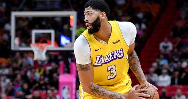 Lakers forward Anthony Davis is guarded by the Miami Heat on Dec. 13, 2019, at American Airlines Arena in Miami.
