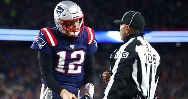 Patriots QB Tom Brady argues a call with head linesman Wayne Mackie during the fourth quarter against the Kansas City Chiefs on Dec. 8, 2019, at Gillette Stadium in Foxborough, Massachusetts.