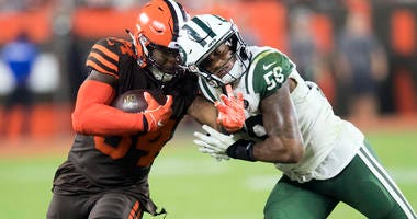 Browns running back Carlos Hyde collides with Jets linebacker Darron Lee on Sept. 20, 2018, at FirstEnergy Stadium in Cleveland.