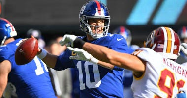 Giants quarterback Eli Manning throws under pressure from Washington Redskins linebacker Ryan Kerrigan on Oct. 28, 2018, at MetLife Stadium.
