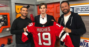 Gregg Giannotti and Jerry Recco pose with Jack Hughes of the New Jersey Devils on June 24, 2019.