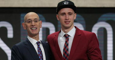 Dzanan Musa poses with NBA commissioner Adam Silver after being drafted by the Brooklyn Nets on June 21, 2018.