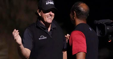 Phil Mickelson (left) shakes hands with Tiger Woods (right) after The Match: Tiger vs Phil golf match at Shadow Creek Golf Course in Las Vegas on Nov. 23, 2018.