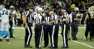 Referees huddle to discuss a call during a game between the Saints and Panthers on Nov. 24, 2019, at the Mercedes-Benz Superdome in New Orleans.