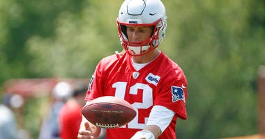 New England quarterback Tom Brady (12) grabs the ball during the mandatory minicamp at Gillette Stadium practice field on June 5, 2019.