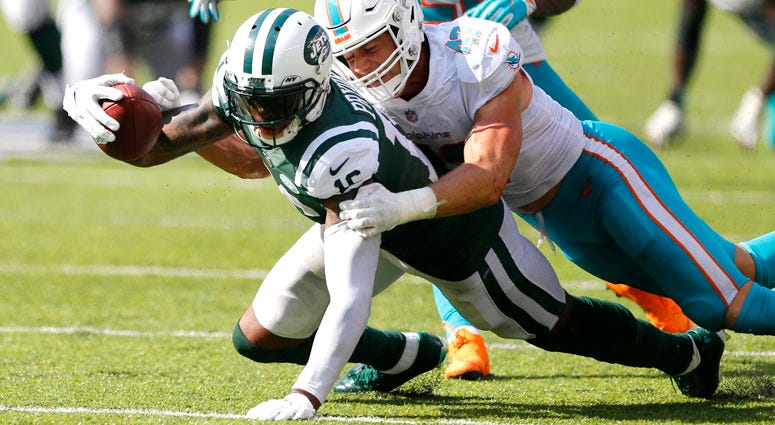 Jets wide receiver Terrelle Pryor is tackled after a catch by Dolphins linebacker Kiko Alonso on Sept. 16, 2018, at MetLife Stadium.