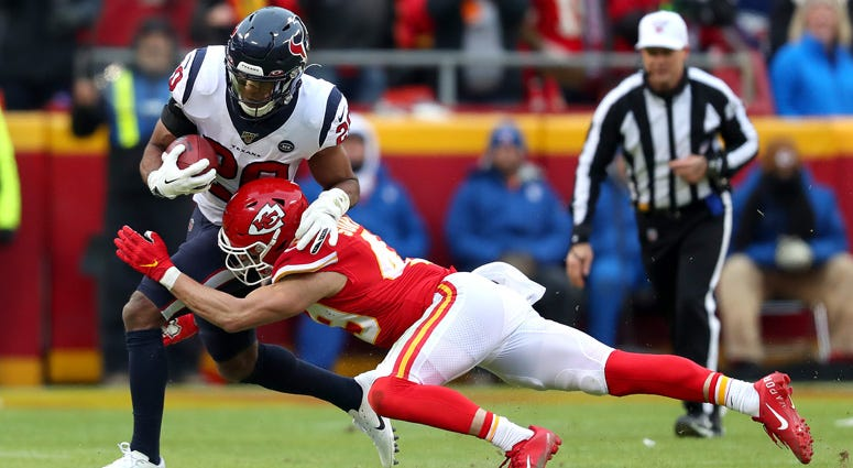 The Texans' Justin Reid is tackled by the Chiefs' Daniel Sorensen on a fake punt during the second quarter in their AFC divisional playoff game on Jan. 12, 2020, at Arrowhead Stadium in Kansas City, Missouri.