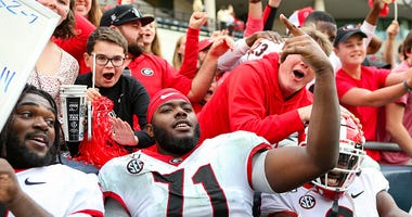 Andrew Thomas celebrates with Georgia fans.