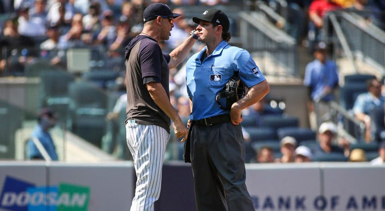 Yankees manager Aaron Boone argues with home plate umpire Ben May on Aug. 17, 2019, at Yankee Stadium.
