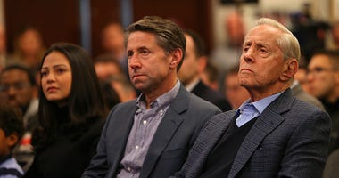 Jeff Wilpon and Fred Wilpon sit during a Mets press conference