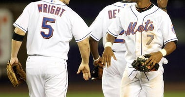 David Wright and Jose Reyes celebrate a Mets win in 2006.