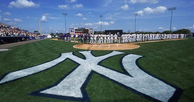 A general view of the players on the field during the national anthem before a spring training game between the Yankees and Blue Jays on March 2, 2001, at Legends Field in Tampa, Florida.