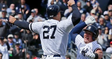 The Yankees' Luke Voit celebrates his three-run home run against the Baltimore Orioles with Giancarlo Stanton on March 28, 2019, at Yankee Stadium.