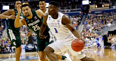 Duke forward Zion Williamson drives to the basket against Michigan State forward Kenny Goins on March 31, 2019, in Washington, D.C.