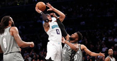 Graham scores 40, Hornets rally to beat Nets