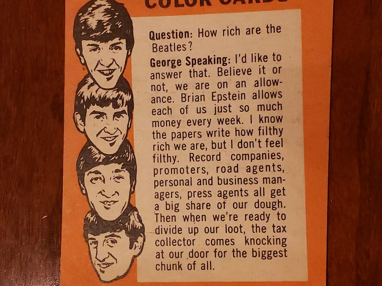 George Harrison takes a question on the back of this Beatles card.