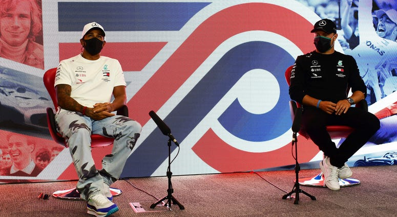 Lewis Hamilton of Great Britain and Valtteri Bottas of Finland and Mercedes GP talk in the Drivers Press Conference during previews ahead of the F1 Grand Prix of Great Britain at Silverstone on Thursday, July 30, 2020 in Silverstone, England.