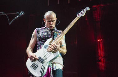 "Musician Michael ""Flea"" Balzary of the Red Hot Chili Peppers performs at Oracle Arena on March 12, 2017"