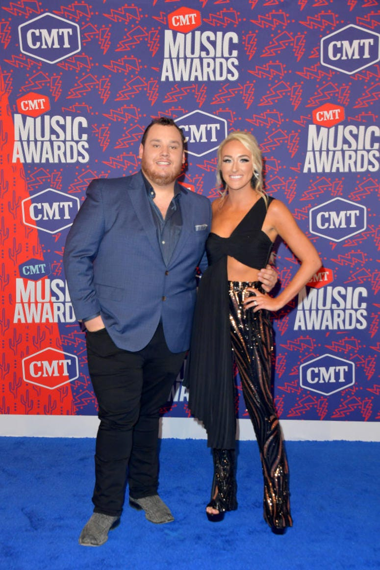 Luke Combs and Nicole Hocking attend the 2019 CMT Music Awards at Bridgestone Arena on June 05, 2019 in Nashville, Tennessee