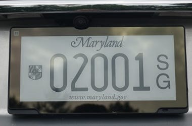 Electronic screen with license plate numbers .