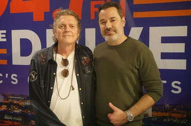 Def Leppard drummer Rick Allen poses for a picture with 94.7 The Drive's Rod Hendrix.