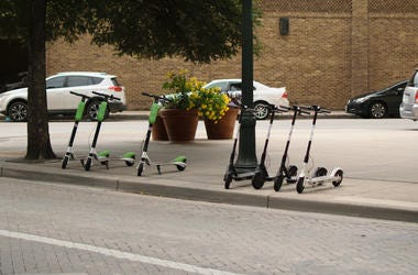 Electric scooters line up on sidewalk in D.C.