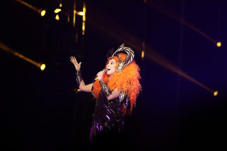 Cher Sining With Head Piece On