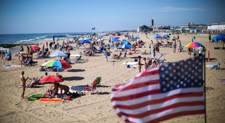 ASBURY PARK, NJ - MAY 26: People visit the beach during Memorial Day weekend on May 26, 2019 i