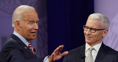 Democratic U.S. presidential candidate and former Vice President Joe Biden (L) gestures with CNN moderator Anderson Cooper at the Human Rights Campaign Foundation and CNN's presidential town hall, focused on LGBTQ issues, on October 10, 2019 in LA