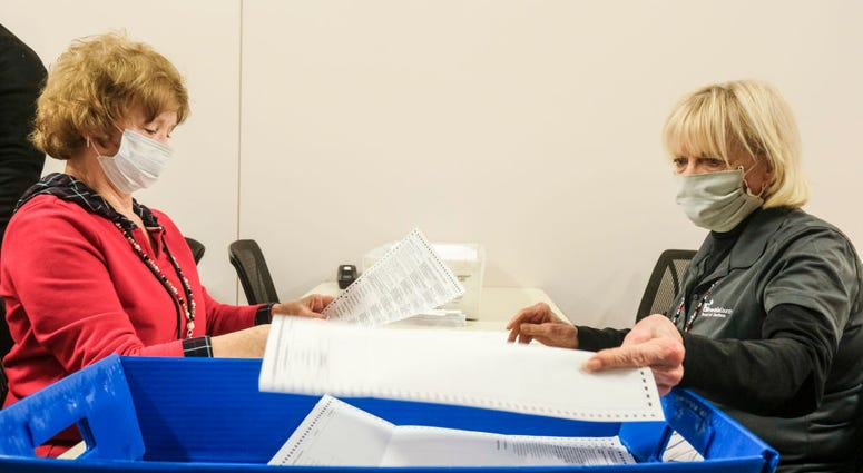 Employees and volunteers of the Franklin County Board of Elections sort through, and de-stub both mail in ballots and provisional ballots on April 28, 2020 in Columbus, Ohio