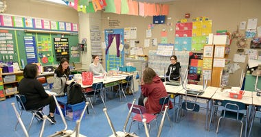 MARCH 19: An IEP phone conference is held in a classroom for a student whose parents need English translation at Yung Wing School P.S. 124 in the Manhattan borough of New York City.