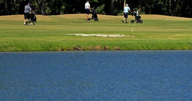 As golf courses change their protocols in response to the coronavirus pandemic, some golfers choose to walk at Westchase Golf Club on March 28, 2020 in Tampa, Florida