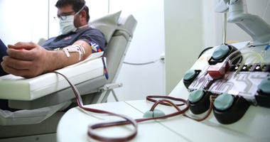 : A recovered Covid-19 patient donates blood plasma for research into Covid-19 antibodies at the medical researcher of the German Center for Immunity Therapy