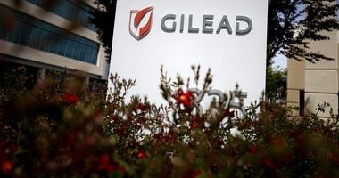 A sign is posted in front of the Gilead Sciences headquarters on April 29, 2020 in Foster City, California. Gilead Sciences announced preliminary results of remdesivir trial