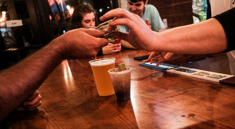 COLUMBUS, OH - JULY 31: Customers enjoy a last round of drinks at a bar in the Short North District on July 31, 2020 in Columbus, Ohio.