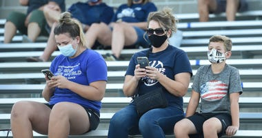 : Fans of the Lincoln North Star Navigators watch the action against the Hastings Tigers from the stands at Seacrest Field on August 21, 2020 in Lincoln, Nebraska. (Photo by Steven Branscombe/Getty Images)