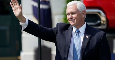 JULY 16: U.S. Vice President Mike Pence waves as he arrives for a speech by President Donald Trump on the South Lawn of the White House on July 16, 2020 in Washington, DC