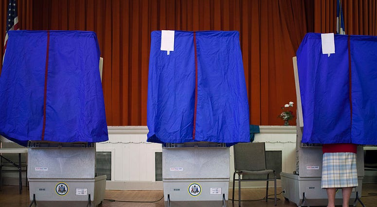 voter cast a ballot in a voting booth during the Republican primary election April 24, 2012 at St. George Greek Orthodox Church in Philadelphia,
