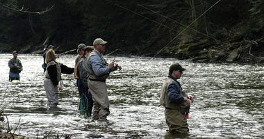 Anglers line up in a section of the Neshannock Creek April 17, 2004 near Volant, Pennsylvania.