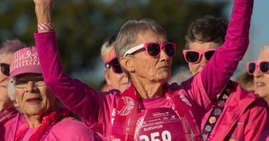 etty Singer, 87, of Evansville is acknowledged as a 47-year breast cancer survivor at the 2018 Susan G. Komen Race for the Cure at Eastland Mall Sunday morning.