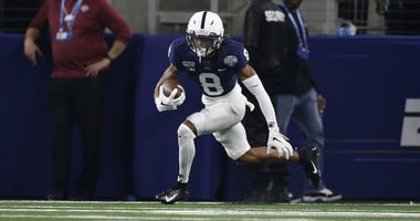 Penn State Nittany Lions cornerback Marquis Wilson (8) returns an interception in the fourth quarter against the Memphis Tigers at AT&T Stadium.