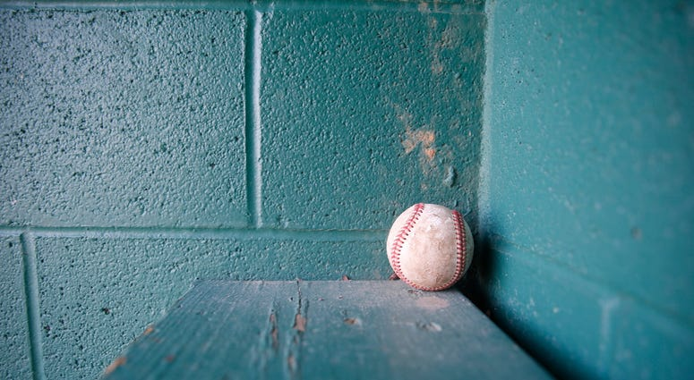 A baseball left inside a dugout at the baseball field at Maurer Geering Park on March 16, 2020. Empty Ball Fields