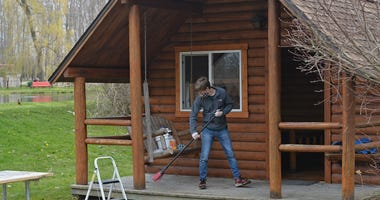 April 28, 2020; Erie, PA, USA;Spencer Conaway, 19, cleans a cabin, April 28, 2020, at the KOA campground in McKean Township. Crews at area campgrounds, marinas and golf course are busy preparing to open Friday