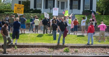 Protesters carried signs and chanted at Gov. Tom Wolf's house in Mt. Wolf on Saturday, May 2, 2020. They want the governor to open the state and let people get back to work. Ydr 502 Wolf Protest 2