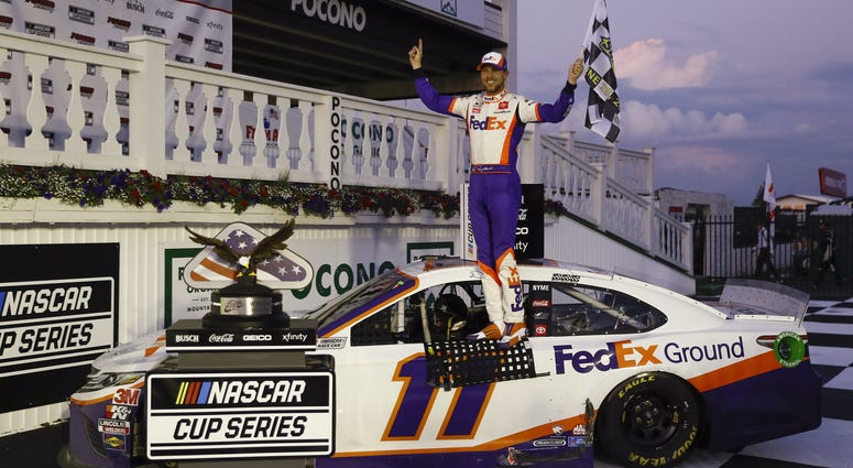 Jun 28, 2020; Long Pond, Pennsylvania, USA; Denny Hamlin celebrates in victory lane after winning the Pocono 350 Cup Series at Pocono Raceway.